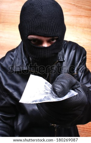 Drug dealer selling heroin or cocaine - stock photo