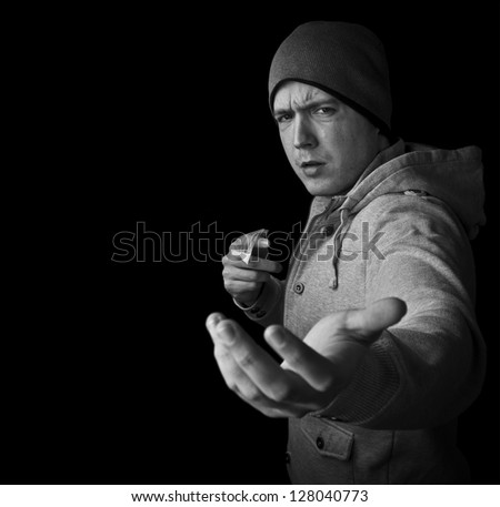 drug dealer selling heroin or cocaine and demanding money black and white with copy space - stock photo