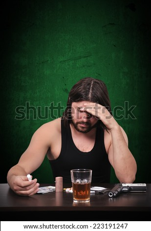 drug dealer thinking and drugs on table - stock photo
