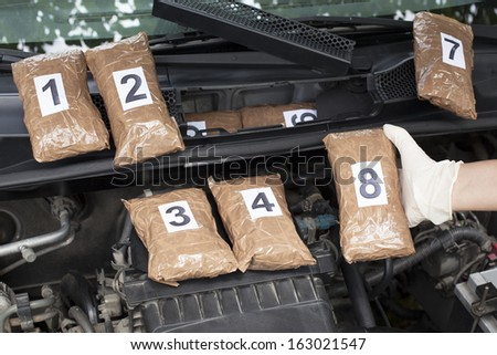 Drug smuggled in a car's engine compartment  - stock photo