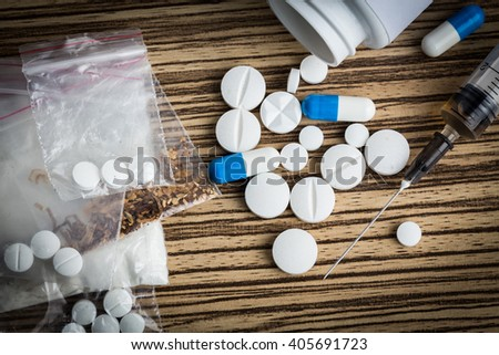 Drug syringe and cooked heroin - stock photo