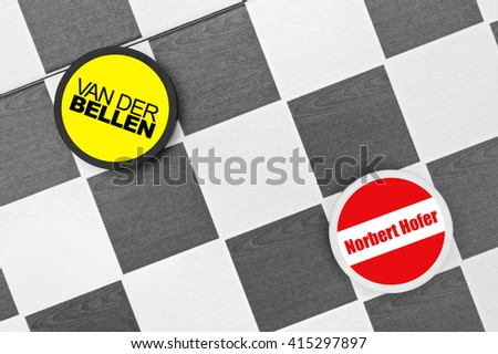 Drughts (Checkers): Austrian presidential election. Alexander Van der Bellen vs Norbert Hofer. Duel of left-wing candidate from Greens party and right-wing one from Freedom Party - stock photo