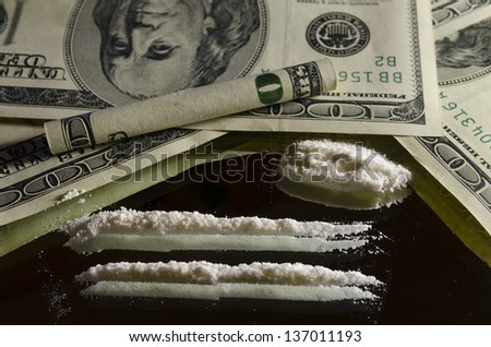 Drugs and money on the mirror - stock photo