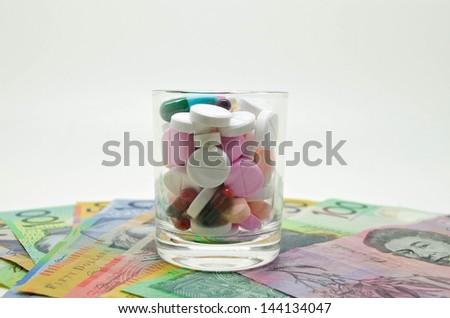 drugs on money background - stock photo