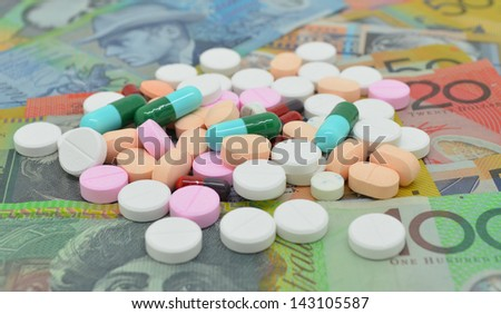 drugs on money background, can be represented how much we have spent on drugs. - stock photo