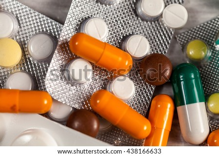 Drugs, pills and medication on table in close up photo. Healthcare treatment - stock photo