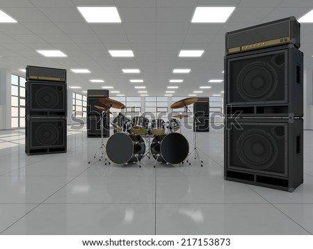 Drum kit and guitar amps in a large empty room light - stock photo