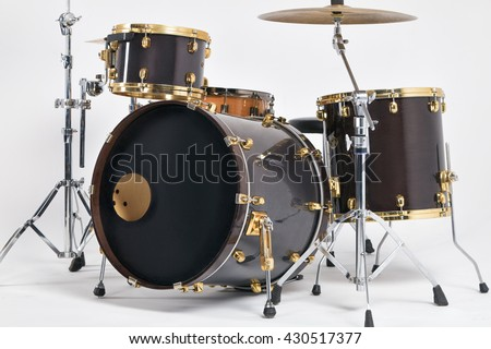 Drum set on a white background, a musical instrument to play rhythm - stock photo