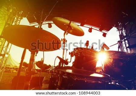Drum set on stage, silhouette - stock photo