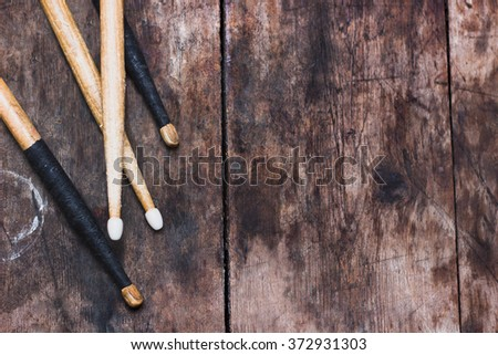 Drum sticks on the wooden background - stock photo