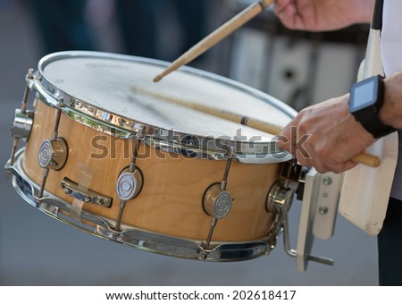 Drummer in a Marching Band. Drummers playing snare drums in parade - stock photo