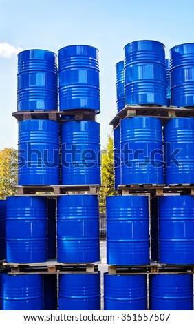 Drums of chemical production on a pallet in the storage of waste. - stock photo