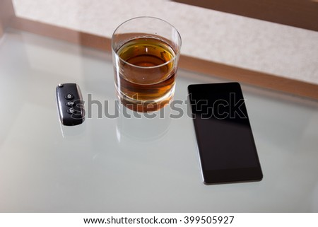 Drunk driving - the cause of car accidents. Drink and keys. - stock photo