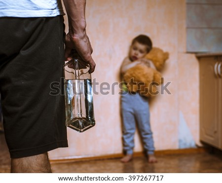 Drunk father and frightened child with toy bear. Domestic violence. - stock photo