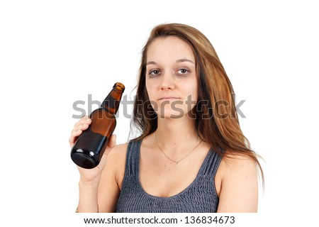 Drunk or alcoholic young woman with beer bottle on white - stock photo