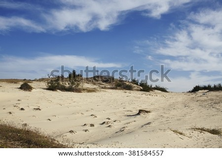 Dry asian scenery under cloudy ornamented sky - stock photo