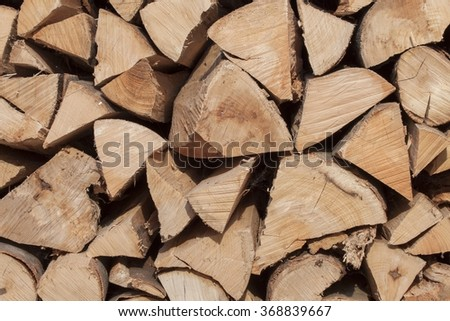 Dry beech wood ready for heating. Wooden logs stacked on top of each other. Stack of wood, firewood, background. Dry chopped firewood logs ready for winter.  - stock photo