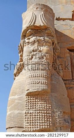 Dry Brush Painting Head of Ruined Assyrian Lamassu Statue in Persepolis, Iran on Sandstone Texture - stock photo