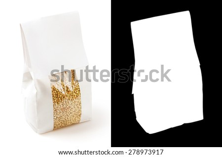 Dry buckwheat packed in paper bag on white background. With clipping mask. - stock photo