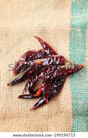 dry chili on the sack cloth - stock photo