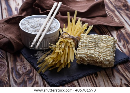 Dry Chinese egg noodles and ramen. Selective focus - stock photo