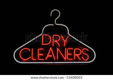 Dry Cleaner Hanger Neon Sign Light - stock photo