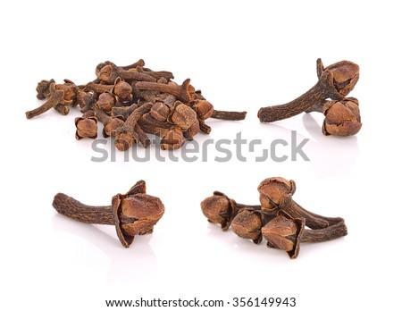 dry cloves on white background - stock photo