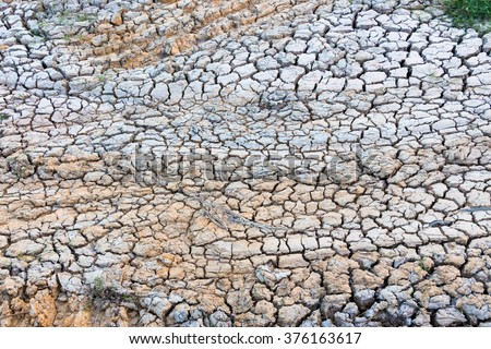 Dry, cracked and colorful dirt texture - stock photo