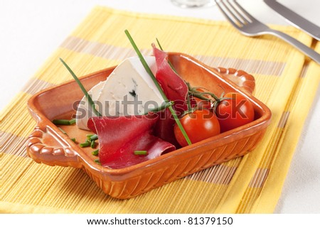 Dry cured ham, blue cheese and fresh tomatoes - stock photo