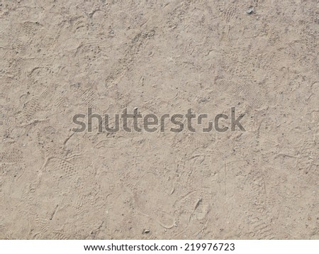 dry dirt road of gravel and sand, and many traces of - stock photo