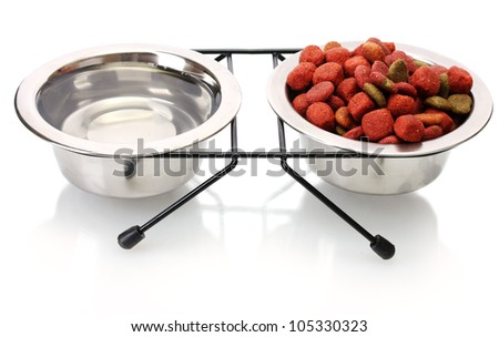 dry dog food and water in metal bowls isolated on white - stock photo
