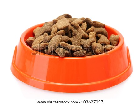 dry dog food in orange bowl  isolated on white - stock photo