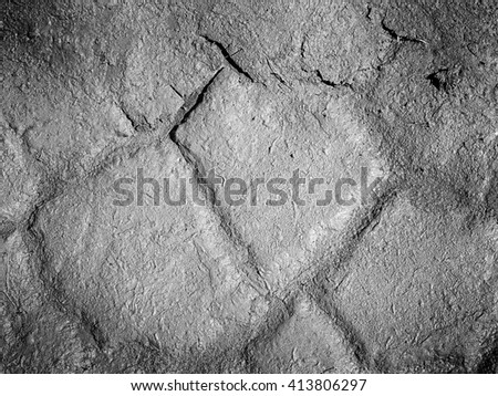 Dry field with natural texture of cracked clay. Dry cracked clay of wheat field. Dusty ground with deep cracks - stock photo