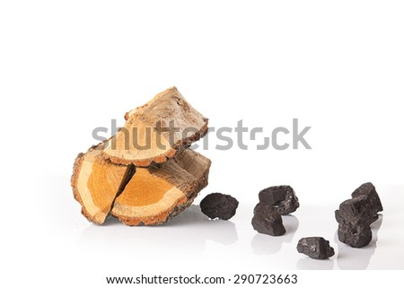 Dry firewood and coal stones isolated on a white background - stock photo