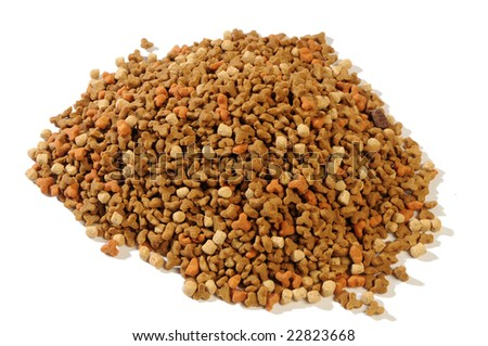 dry forage for kittens with a hen, carrots and milk - stock photo