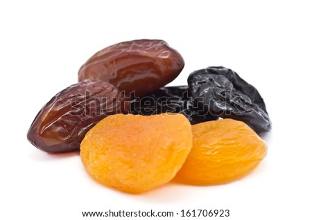 dry fruits pile against white background - stock photo