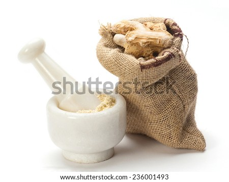 Dry ginger root grated in pestle and mortar with jute bag isolated on white background - stock photo