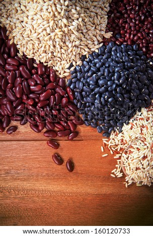dry grain rice food on  top wood table background healthy orgaic useful - stock photo