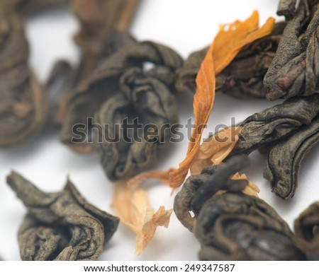 dry green tea with jasmine on a white background - stock photo