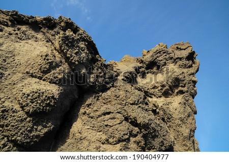 Dry Hardened Lava Rocks Landscape of a Dormant Volcano - stock photo