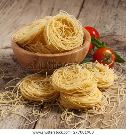 Dry Italian pasta fidellini, selective focus - stock photo
