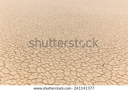 Dry lake bed with natural texture of cracked clay in perspective. Racetrack Playa floor. Death Valley - stock photo