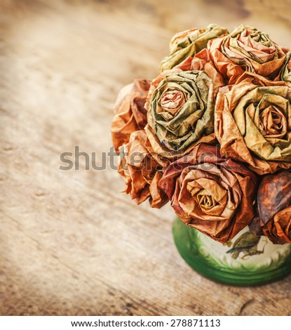 Dry leaf flowers in a bouquet, on old wooden table background,  autumn themes, fall orange leaves - stock photo