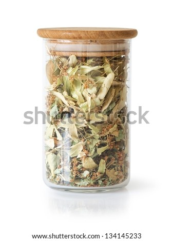Dry Linden blossom in a Glass can with wooden cap, clipping path - stock photo