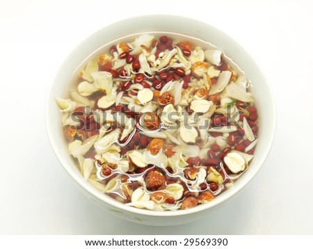 Dry nut and corn such as lotus seed and dry lily petals in the water which prepare to make the cantonese sweet soup. - stock photo
