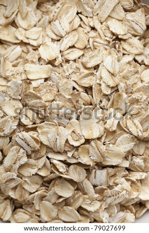 Dry oatmeal in a bowl - stock photo