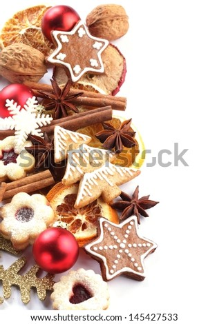 Dry orange and apple slices, spices and Christmas cookies on white background. - stock photo