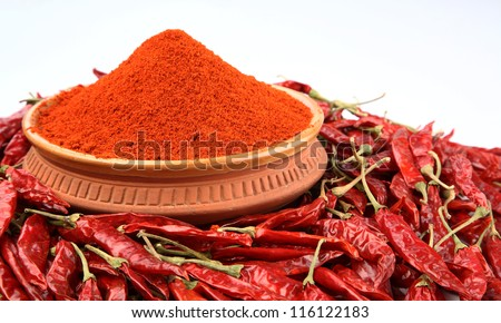 Dry red chili pepper on white background - stock photo
