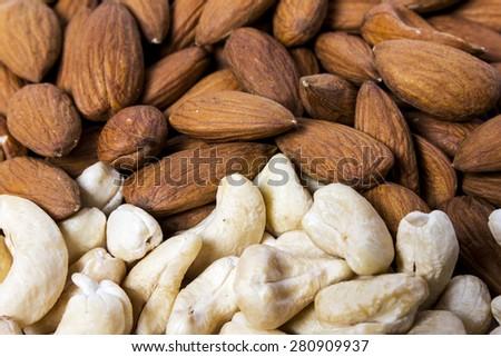 Dry ripe whole almonds and cashews close - stock photo