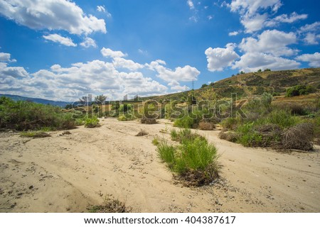 Dry wash in the foothills of southern California on the edge of the Mojave Desert. - stock photo